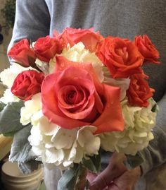 Bridesmaid Bouquet of Salmon Roses, Salmon Spray Roses, White Hydrangeas and Dusty Miller.