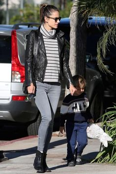 Alessandra Ambrosio wearing Isabel Marant Cluster Boots, Tod's Double T Black Perforated Leather Bag, Anine Bing Moto Leather Jacket in Black, Madewell Ribbed Turtleneck Sweater in Stripe and Black Orchid Amber Zipper Jeans