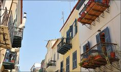 Wandering through the cobblestoned streets with the overhanging balconies in Nafplion Greece Balconies, Wander, Greece, Street, Places, Verandas, Greece Country, Balcony, Walkway