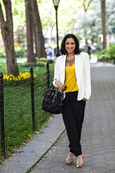 Sunny yellow paired w/ classic black + white and topped w/ a fabulous rainbow necklace. Love the look from @Heather Kennemore | Hitha On The Go