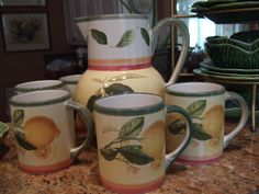 Villeroy and Boch French Country Faience pattern mugs and pitcher....lemon and cherry motif