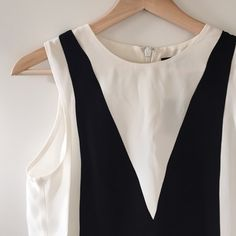"""TOPSHOP Tuxedo Top New with tags. Chic top, perfect for a night out or for work! 86% viscose, 14% polyester. Made in Romania. Pit to pit: 18.5"""". Length: 23"""". Topshop Tops"""