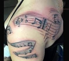 Women's music note tattoo