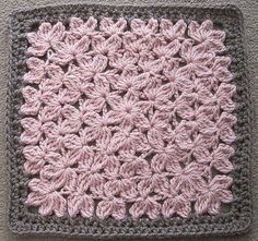 Crocheted in the round like a granny square, it reminds me of a field for flowers