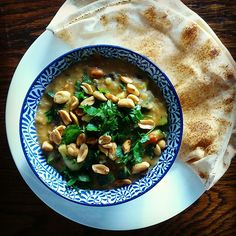 Curry time!; with onion, garlic, fresh ginger, red lentils, coconut milk, vegetable stock, eggplant, zucchini, tomatoes, lemon zest and juice, soy sauce, cilantro, harissa, honey, toasted peanuts and Libanese bread