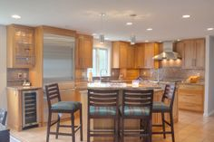 Natural Cherry wood kitchens- :Multi level island design, raised bar height seating for 4, stainless steel appliances, natural cherry cabinets, granite countertops