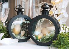 Lantern filled with grass and wooden eggs