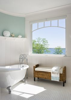 Master Bathroom with a view - natural light bathroom, claw foot tub, high wainscoting, water view