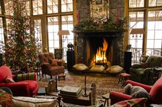 I want this to be my living room! It's the perfect blend of rustic log cabin and homey cottage. :)