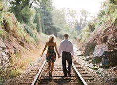 """Jennifer and Hall took off with Eric Kelley Photography to an abandoned train track in Charlottesville, Virginia for a secluded engagement session with that""""runaway"""" feelthat is always so utterly romantic! They also found themselves frolicking in the grass and swinging …"""