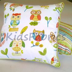 Cushions in ollie marmalade fabric decorated with plain lime green cotton designed by kidsfabrics.co.uk