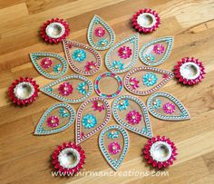 Lotus rangoli - in Blue and Pink. $50.00, via Etsy.    Could DIY?
