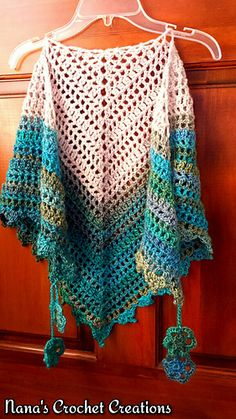 Shawlette. Free crochet pattern.  as made wraps around neck comfortably. It can also be made into a full sized shawl by simply adding rows.