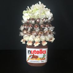 Nutella bouquet with a 950 gram jar of Nutella, hazelnut Lindt chocolates and Capuccino Sorini chocolates. Chocolate Lindt, Chocolate Bouquet, Diy Crafts To Do, Upcycled Crafts, Chocolates, Pots, Halloween Mason Jars, Candy Bouquet, Embroidered Clothes