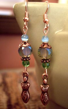 """see om inspirations jewelry on FB. spiral goddess earrings, just under 2 1/2 inches long, dyed blue jade, iridescent blue/green faceted glass beads, faceted green glass beads, copper earwires, bead caps, and findings, """"tierra cast"""" antique copper plated spiral goddess charms, antique copper spacer beads, $18 includes shipping within the U.S. Feel free to send questions to me via facebook email. To order, send payment via paypal: yoginidb@yogafromthegroundup.com"""