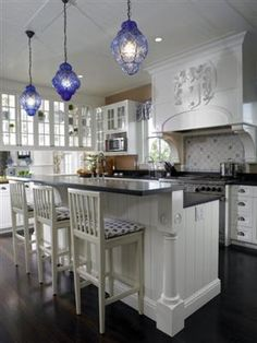 A beautiful white kitchen with accents of blue