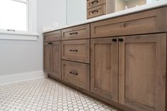 Knotty alder stained cabinets bring out that cozy farmhouse feel........#farmhousevibe #remodeling #silverleafconstruction