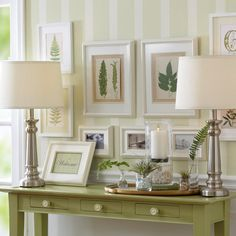 A welcoming gallery wall greets friends and family in an entryway.