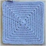 Solid Granny Square. Crochet instructions to make a blanket. Knit-A-Square for charity. Uses single, half double and double crochet stitches.