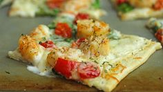 Creamy Alfredo sauce makes a great base for this summery pizza that's ready in 25 minutes.