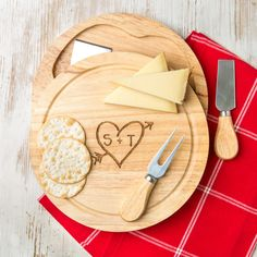 A stunning hevea wood hinged cheeseboard and knives gift set engraved with a beautifully rustic carved initials design The Cheese Board Gift Set is made from