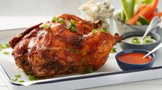 This mashup of Buffalo wings and beer-can chicken combines the best of both worlds for a tender, flavorful bird with spicy flair.