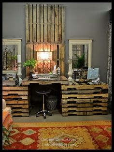 "Pall.ets, Pallets, Pallets! Pallet desk, Pallet walls to hang inspirations & notes on.   Blogger says ""Voila! My New Unfolded Studio Workspace Created with Annie Sloan's Work Book"".  Click to see whole workroom transformed.  Interesting look, I would like some storage in that desk."