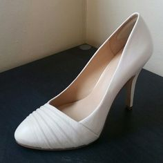 """Nine West """"Quircky"""" Pumps Like new pair of off white pumps. Worn just one time, practically new. Been kept in its box and come from a pet/smoke free environment. Great for the spring/summer! Nine West Shoes Heels"""