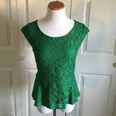 Green Lace Peplum Top Green lace peplum top from EXPRESS. Worn once or twice. In excellent condition. Gold zipper in back. Express Tops Blouses