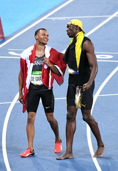 Andre de Grasse of Canada and Usain Bolt winner of the Men's 100m final on Day 9…