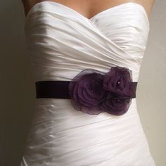 gorgeous wedding dress with a splash of purple <3