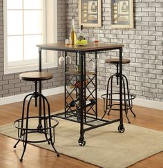 "3 pc Silvia I collection industrial style bronze metal finish and square wood top bar height table set . Set includes table and 2 chairs with wood seats. Table measures 30"" x 30"" x 42"" H. Chairs measure 22 1/2"" x 22 1/2"" x 28 3/4"" - 35 3/4"" H. Additional chairs also available separately. Some assembly required."