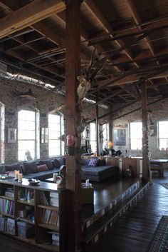 If I could choose any place to live, I would love to live in an old warehouse apartment/condo. There have to be brick walls though.
