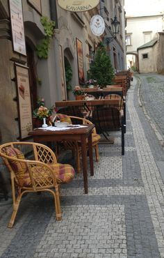 Prague - sit at a sidewalk cafe and watch the world.