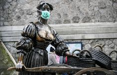 As the medical importance of face masks has increased during the pandemic, so has their symbolic value. Statues from Melbourne to Buenos Aires have been decorated with protective masks