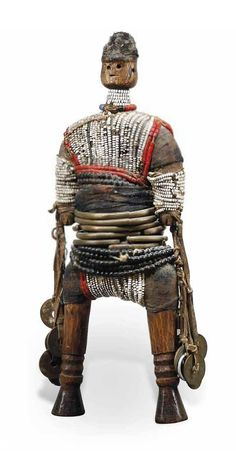 Africa | Doll from the Namji people of Cameroon | Wood, glass beads, metal, leather, fiber