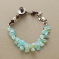 """STREAM OF OPALS BRACELET -- Embellishments of leather and sterling silver accentuate the watery hues of Naomi Herndon's stream of faceted Peruvian opals. Button closure. Handmade in USA. 7-1/2""""L."""