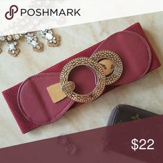 Red and Tan Belts w/ Gold Decal Both colors are available for purchase. Brand new in excellent condition. Never worn. In original packaging. Elastic Band. Hooks in front. Fast shipping! No trades. Thank you for supporting and shopping my closet! Xoxo Accessories Belts