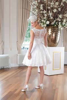 Wedding dress WR27 by Mylène Sophie is a super cute short vintage style dress. The satin bodice is overlaid with a sophisticated delicate ivory lace.