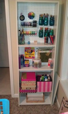 Me getting organized...mounted peg board to the shelf...colored the mason jars w/ modge podge and food coloring- covered shoe box w/ craft paper...very functional:)