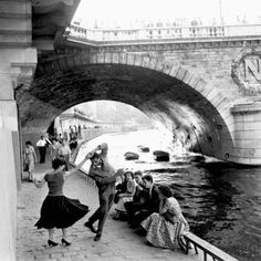 dancing next to a bridge