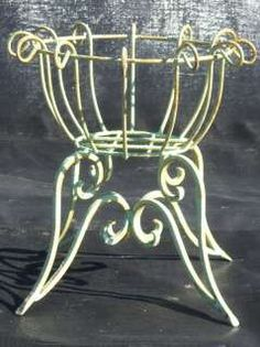I like the look of this wrought iron planter, and also like that the bottom legs are wide so that it is sturdy.