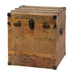 Reclaimed bleached pine wood trunk with metal accents.    Product: Trunk    Construction Material: Reclaimed pine    Color: Bleached pine   Features:  Rustic sophistication    Artfully crafted    Authentic appeal   Dimensions: 24 H x 22.5 W x 22.5 D