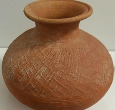 POT WITH OVERALL PADDLE-IMPRESSED TEXTURE. Song dynasty earthenware pots,  Earthenware pot is made from a red clay....