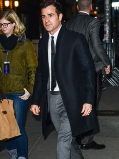 """Justin Theroux, 5'9"""" style legend, has a sneaky way of looking taller: an every-so-slightly cropped topcoat."""