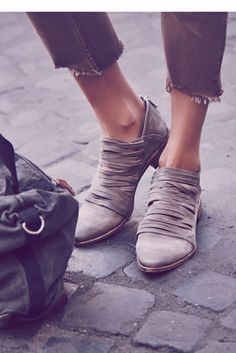 Free People Womens Lost Valley Ankle Boot by: Free People @Free People (Global) Inspired by our very own Hybrid Heel Boot this Italian leather ankle boot has a strappy body and a stacked heel. Zip up closure on back. By Free People