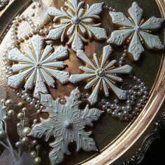 Snow-flakes embellished with gold and silver by Teri Pringle Wood