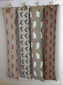 Draught excluders in Emily Bond Dairy Cow and Dachshund fabrics Draught Excluder Diy, Draught Excluders, Sewing Hacks, Sewing Crafts, Sewing Projects, Textile Prints, Textiles, Draft Stopper, Door Stopper