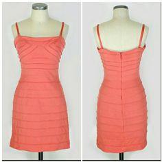 "BCBG MAX AZRIA coral bandage bodycon dress Sz 10 (M).  BCBG MAX AZRIA coral bandage dress. Removable adjustable straps. 79% rayon 15% nylon 6% spandex. Great condition no flaws. Approx unstreched measurements Bust 33"" Length 31.5"" Waist 28"" Hips 34"". BCBGMaxAzria Dresses Mini"