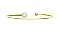 18kt yellow gold cuff bracelet by Jemma Wynne.  With a single bezel diamond and white pearl.